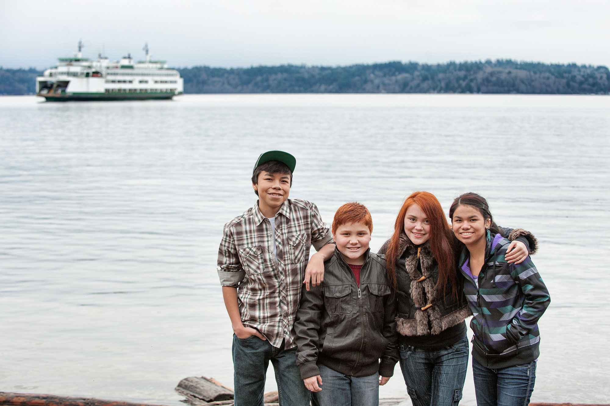 Kids posing while ferry boat arrives to the dock in West Seattle.