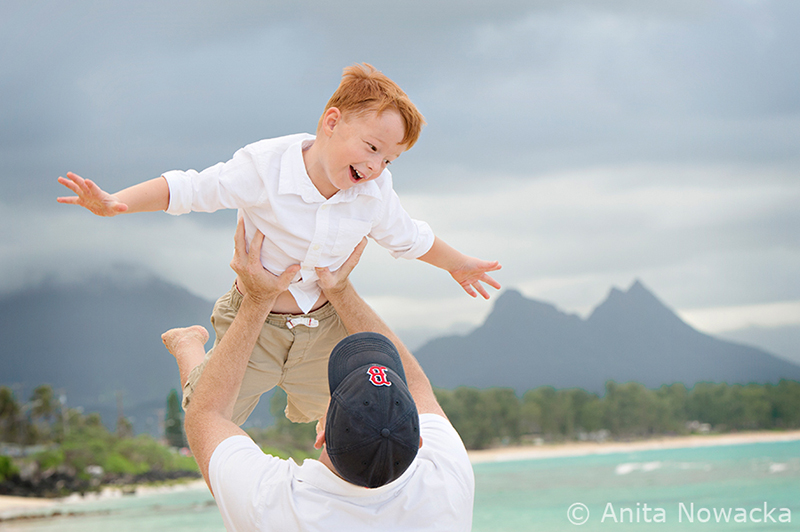 Boy having a great moment with dad during family photo session
