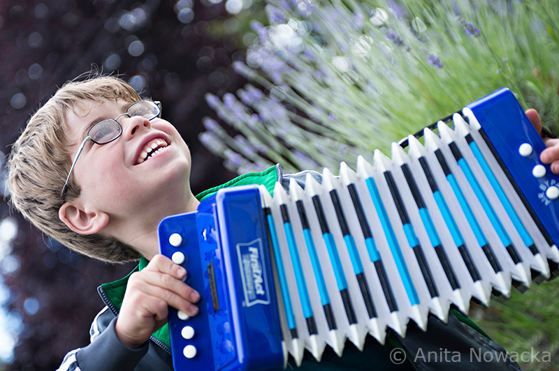 Boy smiles while he discovers new sounds on his instrument