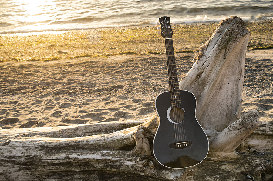 Guitar and sun set